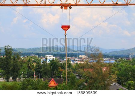 Crane Hook in create building with blue sky