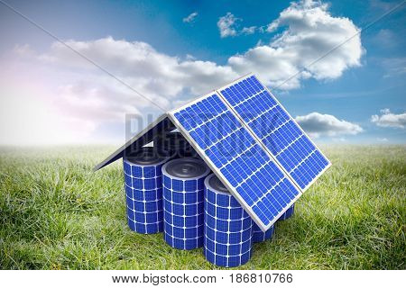 3d image of house model made from solar panels and cells against sunny landscape