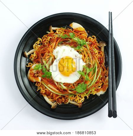 Hot Chili Ramen Noodle With Egg And Mushroom In Black Stew