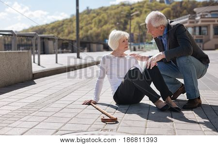 Sudden paid killed us. Weak aged pleasant woman having bad pain in her body and asking for help while kind passerby listening to her