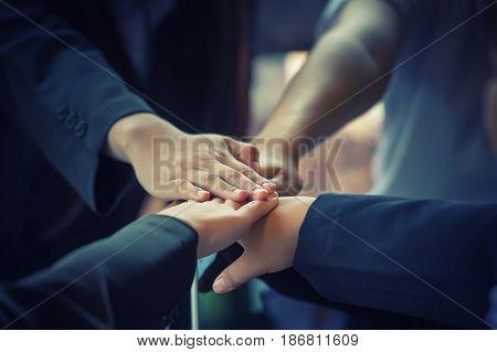 Business People Coordinate Hands. Concept Teamwork.