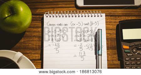 Trignometry against black background against directly above view of coffee cup by book with apple and calculator