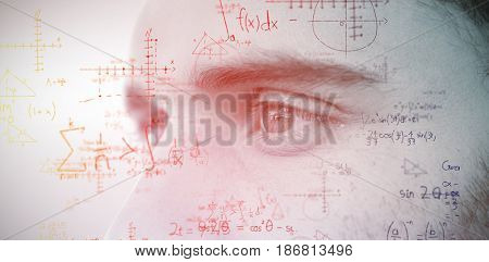 Man with blue eyes looking away against grey background