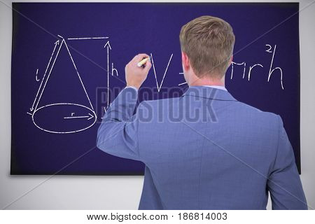 Businessman writing on a white background against black chalkboard