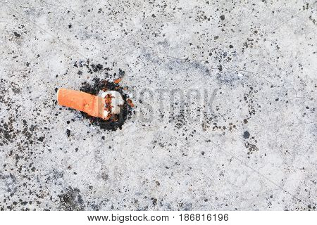 cigarette butt. on the cement floor Smoking bad for health. concept Non-smoking day universal