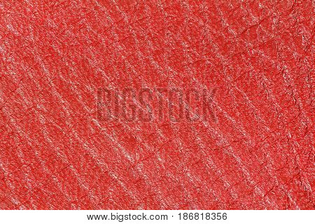 Red leather texture, leather background for design. Pattern of leather that occurs natural.