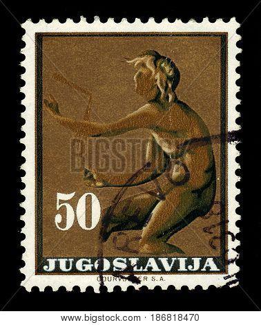 Yugoslavia - CIRCA 1962: A stamp printed in Yugoslavia shows God Kairos (relief Trogir monastery) 300 BC, circa 1962