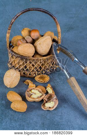 Nuts mix in shell - walnuts hazel and almonds in wicked basket