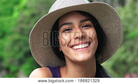 A Beautiful Young Teenager Wearing a Hat