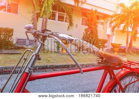 bicycle Handle red classic vintage in former beautiful on the road with light sunrise tone