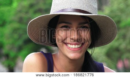 A Colombian Latina Girl Wearing a Hat