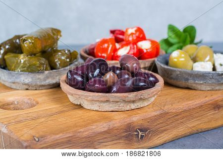 Mediterranean appetizer antipasti tapas bowls with green and calamata olives feta cheese stuffed pepper herbs