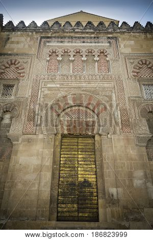 Golden doorway on high exterior wall of the mosque-cathedral of Cordoba