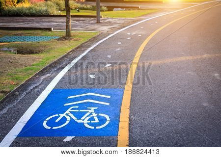 Bicycle lane, Bicycle track with road and sunset in public park for designed to make cycling safer.