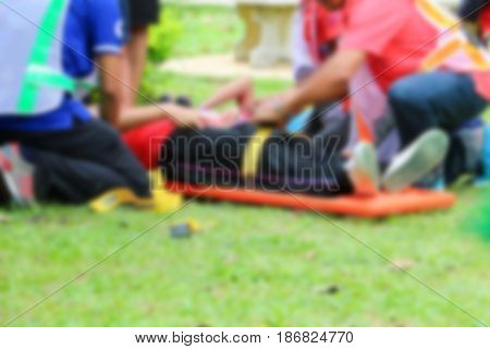 blurred of emergency medical service. Paramedic is pulling stretcher with assist a patient in rescue situations.