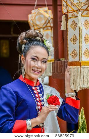 NAKORN PHANOM THAILAND - FEBRUARY 14 2015: Thai northeastern Phutai dancer with traditional costume in Phutai world event day in Renunakorn of Nakorn Phanom Thailand.