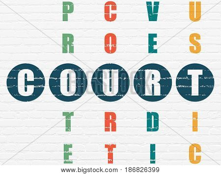 Law concept: Painted blue word Court in solving Crossword Puzzle
