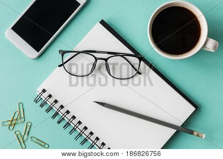 Top View Of Notebook With Cup Of Coffee And Smartphone With Glasses Mock-up, Small Office Home Offic