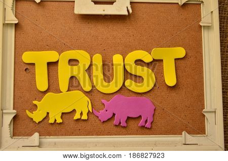 word trust on a  abstract colorful background