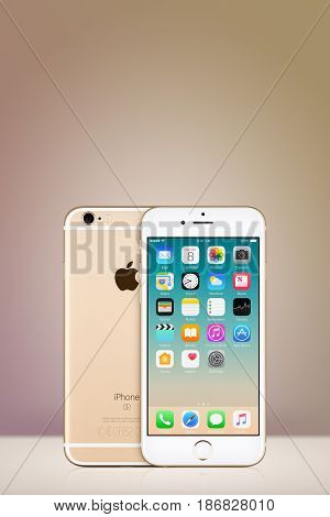 Varna, Bulgaria - March 10, 2016: Gold Apple iPhone 7 with iOS 10 on the screen and back side on vertical gray gradient background with copy space. Quick mockup for your design.
