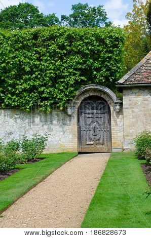 Path to gate in traditional English garden