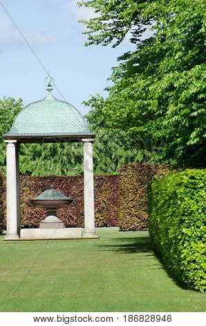 Arched Gazebo with Sculpture in English Garden