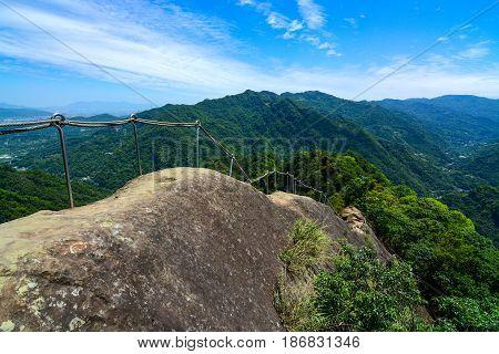 Makeshift hand railing along a dangerous section of mountain path on the Wu Liao Jian trail in Taiwan