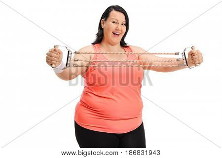 Joyful overweight woman exercising with a resistance band isolated on white background