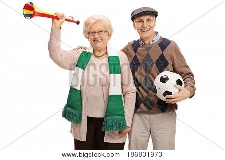 Cheerful elderly soccer fans with a trumpet and a football isolated on white background