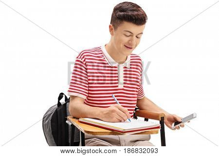 Teen student cheating on a test with a phone isolated on white background