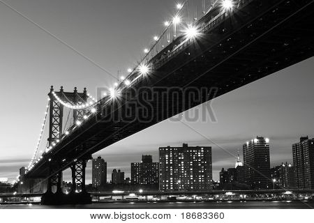 New York City Skyline and Manhattan Bridge At Night