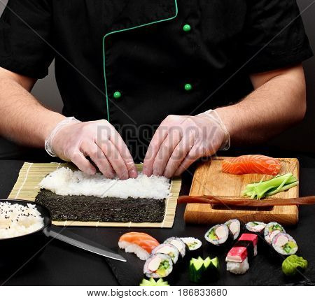Chef Making Sushi .sushi Roll Process Of Making Raw Makki Fresh Seafood Susi.