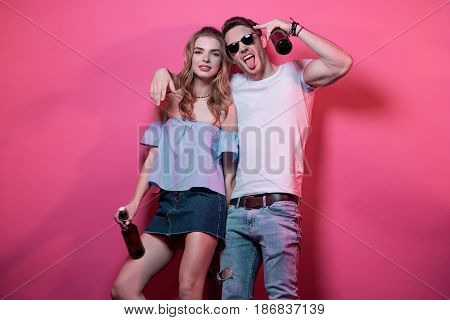 Young Stylish Couple At Casual Clothes Posing And Fooling Around, Young Couple In Love