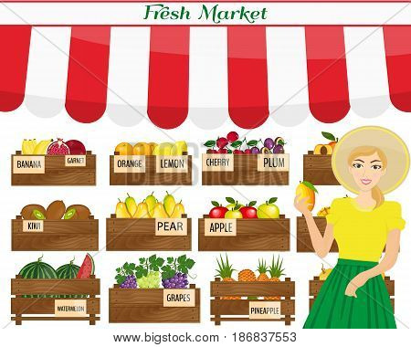 Female worker of grocery store holding a mango. Local market farmer selling fruits produce on his stall with awning. promote healthy eating concept. Food market.