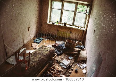 Room in an abandoned building, broken furniture, Asylum or shelter or Housing of homeless people