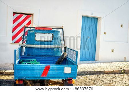 Small italian motorbike parked in Gallipoli Puglia Italy