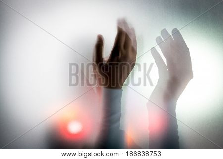 Muslim woman hands up for prying