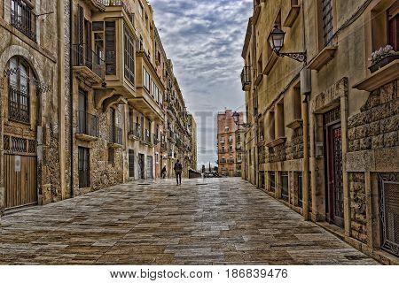 Spain Tarragona ancient narrow street in  summer
