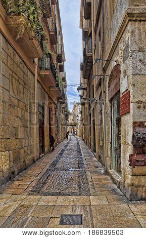 Spain Tarragona ancient narrow street in spring