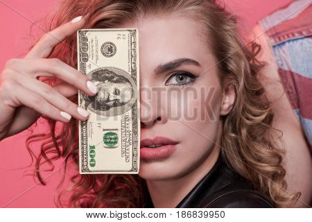 Portrait Of Woman Covering Face With Dollar Isolated On Pink
