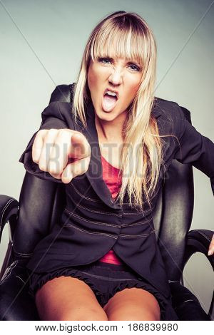 Angry woman yelling and pointing