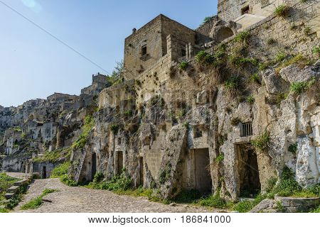 beautiful ancient ghost town of Matera (Sassi di Matera) in beautiful bright sun shine with blue sky south Italy