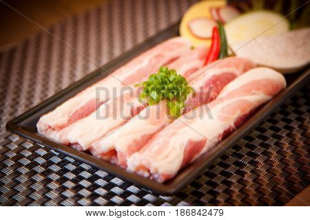 Fresh Sliced Pork With Onion And Lime On Tray