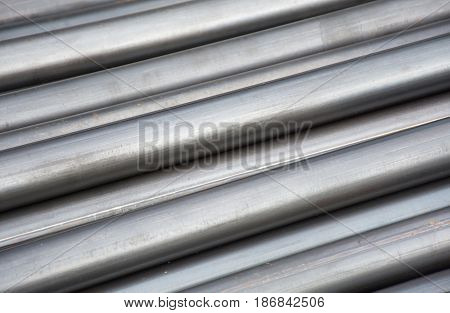 Soft focused picture of Division round steel pipe in Factory Texture background