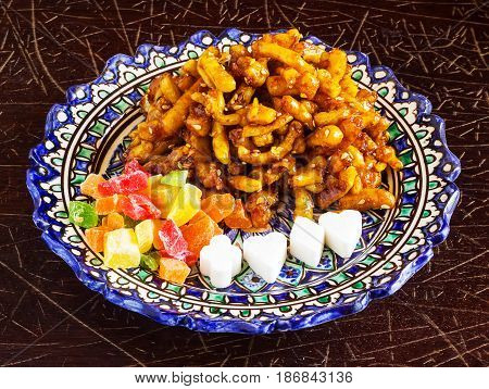 Eastern Sweets, Dried Fruits And Sugar On A Traditional Plate