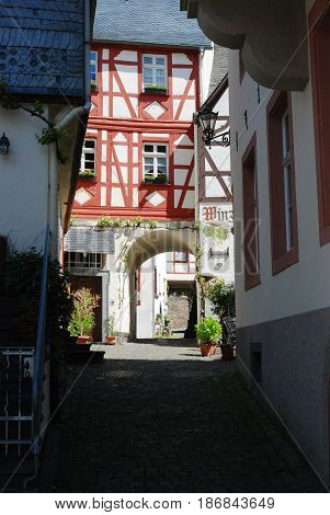 looking down old historic cobbled street & archway in Beilstein Germany