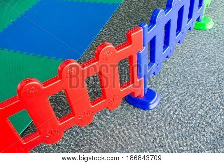 Soft focused picture of kids playground fence and Elastic Rubber Floor background