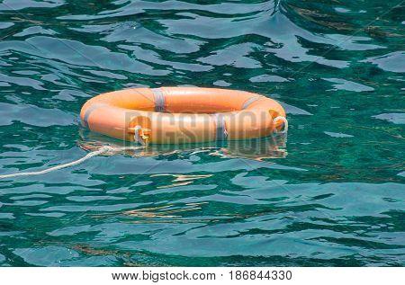 Orange Life preserver on Ocean surface water
