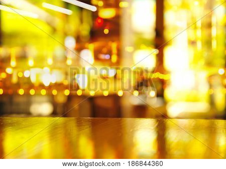 reflection light on top of wood table in cafe bar or pub background
