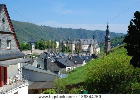view of old town walls church and houses of Cochem Germany